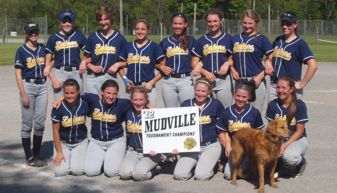 Members of the Cazenovia varsity softball team gather for a group photo after clinching victory in the 2012 Mudville Tournament, May 19 at the Mudville Softball Complex located near Herkimer.
