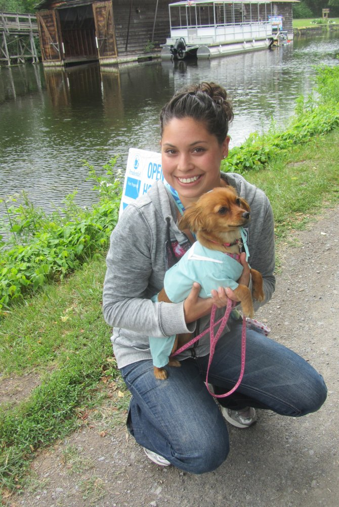 "Christina Kistler, of Camillus, holds Lulu, a 10-month-old Chiweenie. The scrubs won Lulu a ribbon for ""best dressed"" among small dogs at the Camillus Erie Canal Park's second annual dog show held June 3."