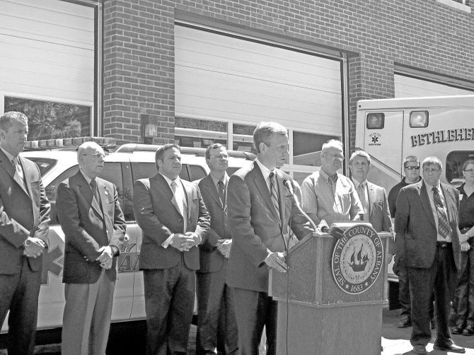 Bethlehem Supervisor John Clarkson announces the new contract agreements that will save taxpayers and the town money in providing Advanced Life Support services to residents, while county paramedics and town EMS providers look on.