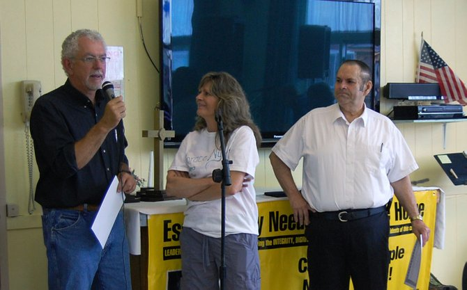 Moriah Supervisor Tom Scozzafava, left, and Chesterfield Supervisor Gerald Morrow, right, were speakers at the Save Horace Nye rally June 2 in Elizabethtown. Event organizer Celeste Beeman watches.