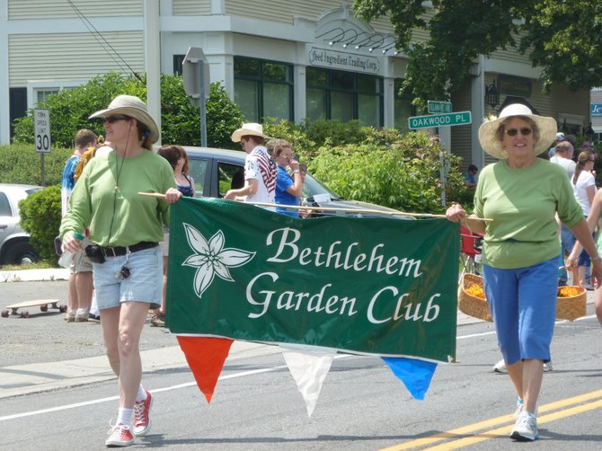 The Bethlehem Garden Club promotes their annual plant sale while walking in the Memorial Day Parade. The Bethlehem Garden Club Plant Sale will be held Wednesday, June 13, from 3 to 7 p.m. at the Delmar Presbyterian Church. The Garden Tour will be held the same day from 4 to 8 p.m.