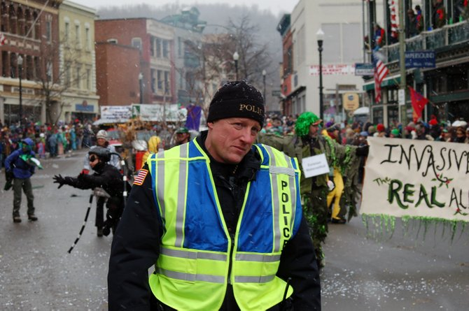 Saranac Lake Police Chief Bruce Nason patrols Main Street during the Saranac Lake Winter Carnival.