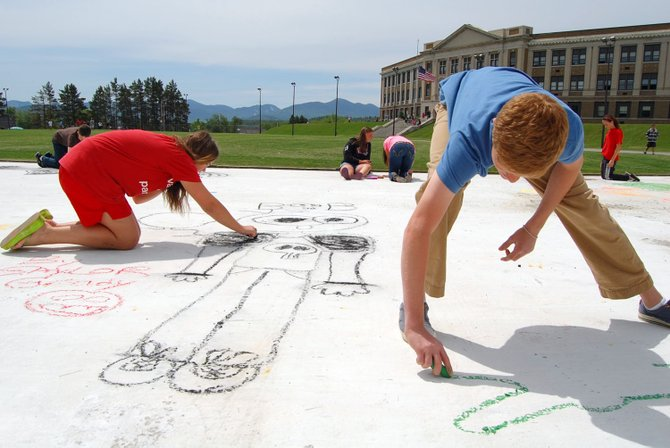 Lake Placid Central School students draw chalk portraits on the Lake Placid Olympic Center speedskating oval June 1, part of  to rally community support for a drug and alcohol awareness program. About 130 students from grades 6 through 12 participated in the temporary art project, drawing self portraits and other drawings to raise awareness for an upcoming poster campaign.