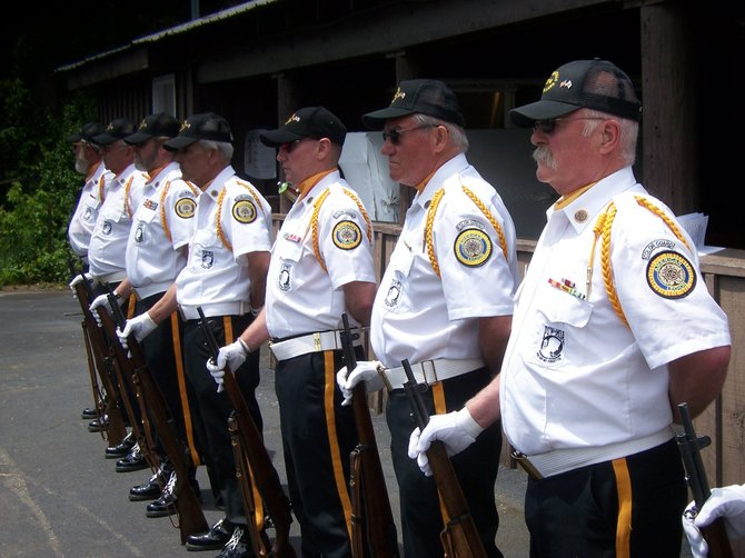 The Rifle Squad of the Hudson Falls American Legion Post 574 stands guard Sunday June 3 during the region's annual POW-MIA memorial service — held this year at the American Legion Post in Lake George rather than at its traditional site atop Prospect Mountain.