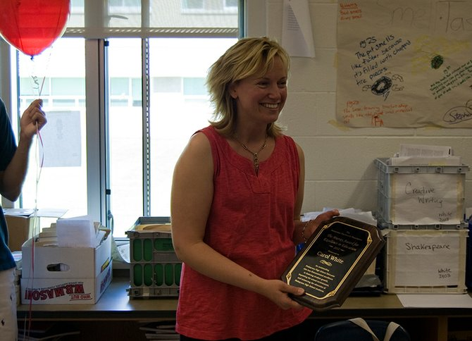 Niskayuna High School english teacher Carol White receives the Murray Award for Excellence in Education on Friday, June 1. White was surprised in her classroom as a television camera, reporters, photographers and ballons left White blushing.