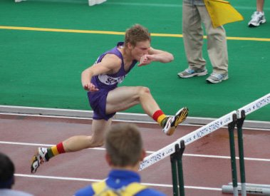 Jay Hebert of Ticonderoga races to victory in the 110-meter hurdles at the New York State Federation Meet.