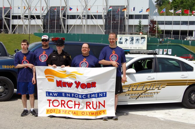 The Special Olympics Torch run made its way through Saranac Lake and Lake Placid June 1.