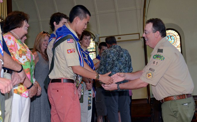 Newly-recognized Eagle Scout Alex LaGrow, center, thanks his mentor Brian Underwood during a special Boy Scouts of America ceremony Sunday, June 10.