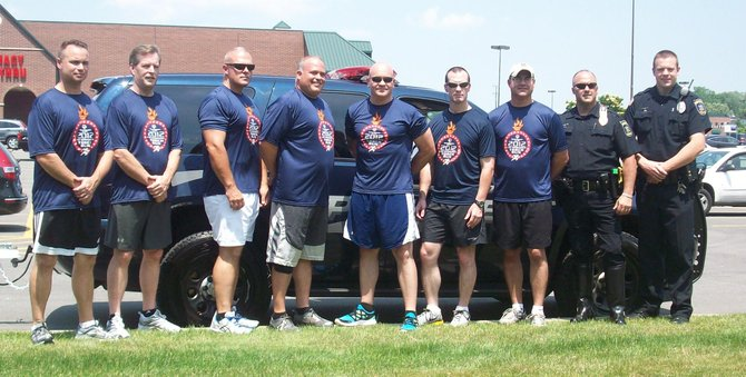 Members of the DeWitt Police Department gathered at the Fayetteville Town Center before starting their leg of the torch run down East Genesee Street.