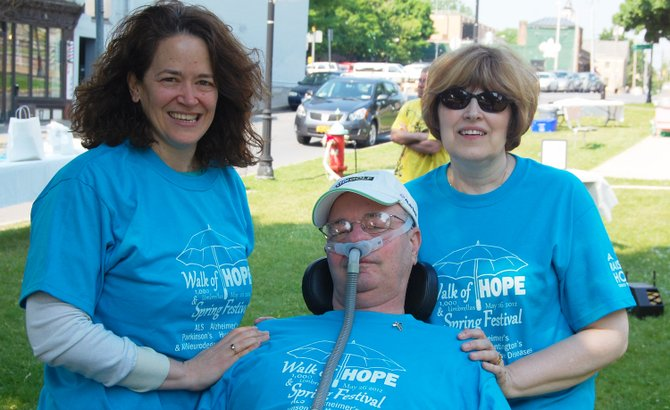 Left to right, Dr. Merit Cudkowicz stands with Roger and Darlene Long at the Walk of Hope in Plattsburgh. The Raising Hope Golf Tournament is July 28.