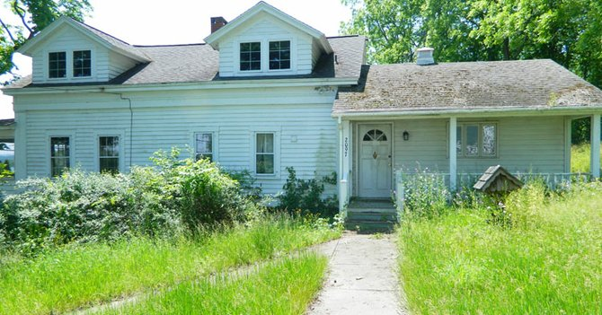 The Skaneateles Town Board is hoping to prevent blight and public health or safety issues with the proposed new law on property maintenance. The law would allow the town to hire a third party to maintain a neglected property, such as the property pictured here on West Lake Road in Mandana, which has had issues for the past three years.