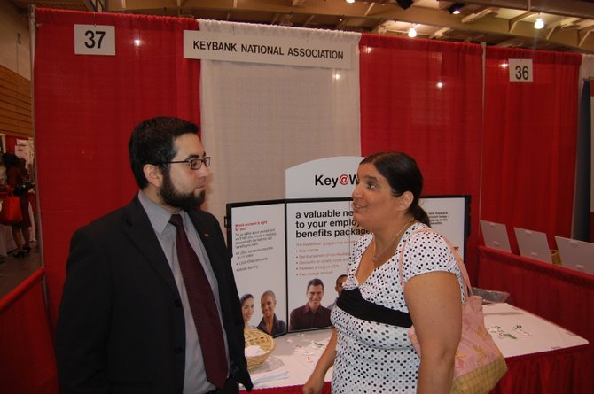 Esteban Munoz of Key Bank speaks to a potential customer at the Business Expo.