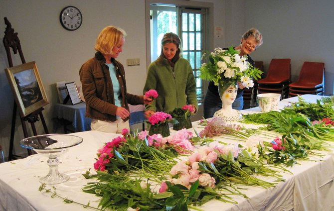 Friends of Lorenzo trustees Lisa Brownback, left, Leanne Burrell and Suzanne Phillips sort and arrange fresh-cut flowers in preparation for the 2011 Garden Gala, which will be held from 6 to 8 p.m. June 15 at Lorenzo State Historic Site.