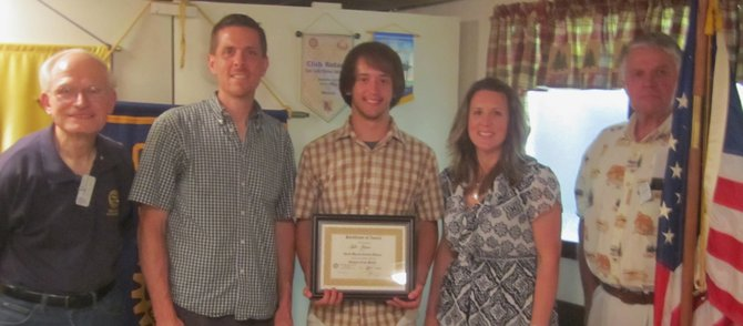 Participating in a recent Chestertown Rotary Club academic award presentation are (left to right): Rotary official David Schlansker, Paul Jensen, Tyler Jensen, Lisa Jensen and Rotary Club president John Hagmann.