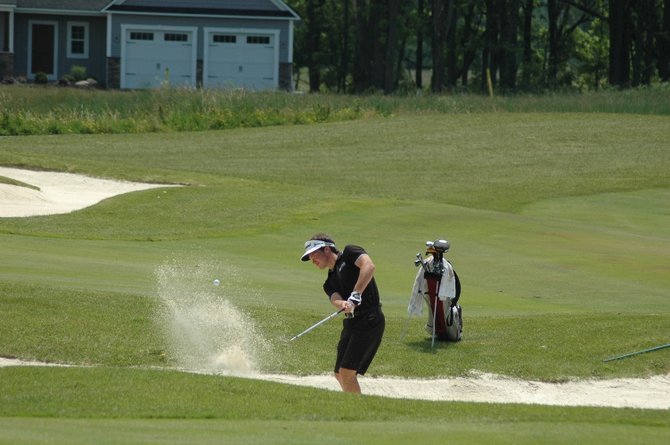 Baldwinsville native Brendan Polsin hits out of a bunker on his way to a first-place finish in the Optimists sectional qualifier at Timber Banks. Polsin, with an even-par 72, advanced to the Optimist International Junior Gold Championships at PGA National in Florida late next month.