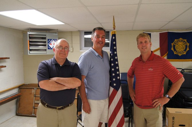 Dave Porter, left, stands beside Jim Joseph and Tim Mahoney after hearing the vote count for the Cazenovia Village Board on June 19 in the American Legion Hall. Porter was re-elected to village board with a total of 321 votes, and Joseph will serve his first two-year term on the board after receiving a total of 309 votes. Mahoney narrowly missed re-election, receiving 238 total votes.