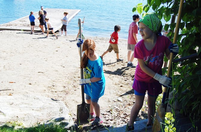 Students participate in a community service clean-up day at Ballard Park on June 14.