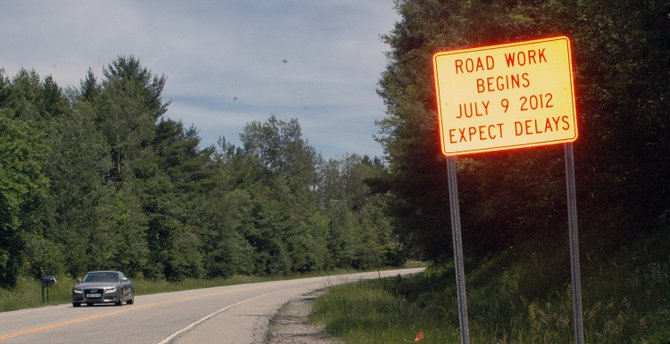A sign tells commuters that repairs to Willsboro Mountain Road will start July 9.
