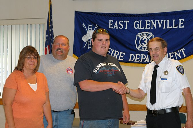 Nicholas Abel on Monday, June 11, was inducted into the East Glenville Fire Department, joining his mother, Tracy, and father, Ken, in volunteering for the fire company. From left: Tracy and Ken Abel stand with their son, Nicholas, and Fire Company President K. Wayne Bunn after the induction ceremony.