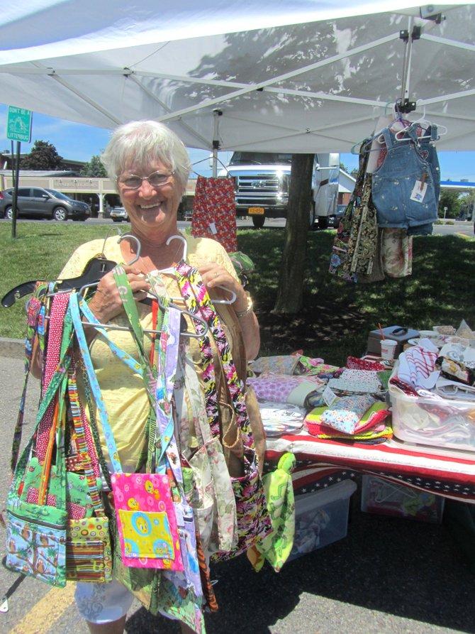Karen Jackson of Kirkville displays her handmade bags at the Manlius Farmer's Market.