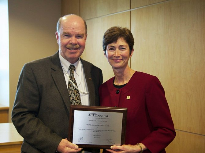 Mac MacMurray (left), chairman of the C&S Companies, presented Debbie Sydow, president of Onondaga Community College, with a 2012 American Council of Engineering Companies Engineering Excellence award.