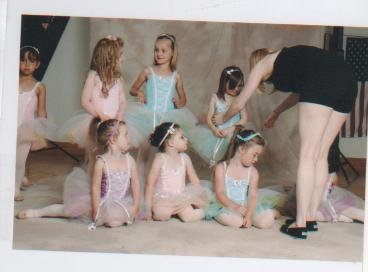 Dance instructor Jessica Foley works on posing a group of her younger students during a recent photo session at her new Hidden Talents Studio In the River Street Plaza in Warrensburg. Foley's enterprise fills a gap after the retirement of Florence LaPoint, who for decades annually taught more than 100 students and held recitals, drawing audiences that would pack the local school gymnasium, eager to watch the glitzy show-tune routines. Foley's Hidden Talents Studio will be holding its first season-ending recital at 12:30 p.m. Saturday June 30 in the Kenington Elementary School auditorium, Kensington Road, Glens Falls.
