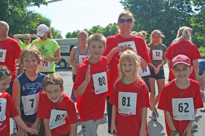 More than 50 runners turned out for the annual St. Mary's School Nun Run in Ticonderoga. Javeed Nazir claimed top honors, touring the mile course in 4 minutes, 51 seconds. Katherine Zelinski was the first woman to cross the finish line in 7:03.