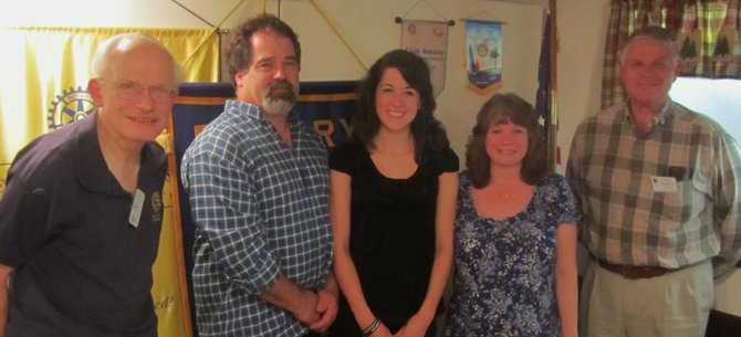 Participating in a recent Chestertown Rotary Club academic awards presentation were: honored North Warren High School student Amanda Millington (center), plus (from left): Rotarian David Schlansker, Amanda's father Bill Millington, and (to Amanda's right):, Amanda's mother Donna Millington, and local Rotary Club President John Hagmann.