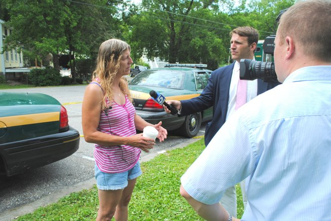 Michelle Moss, a resident of Vergennes, was a friend of the victim who drowned in the Otter Creek on the evening of June 21. Here she is being interviewed by news reporters in Frog Hollow in Middlebury June 22.