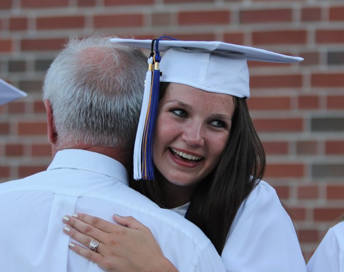 Marissa Titus, Class of 2012 valedictorian, is congratulated following graduation ceremonies at Crown Point Central School.
