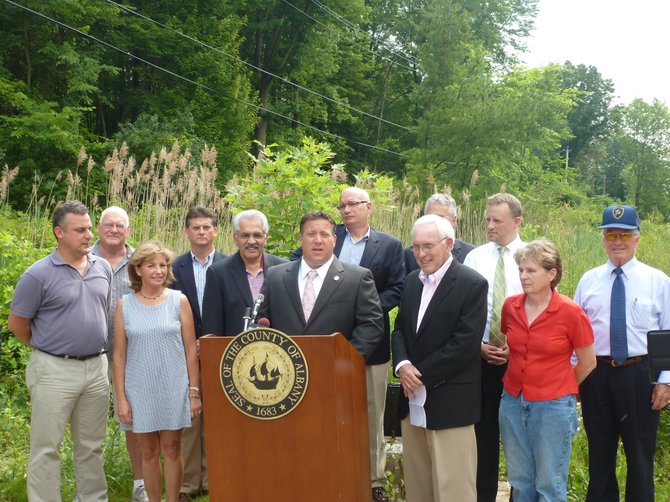 Albany County Executive Dan McCoy announces work will begin to spruce up a 2.4-mile section of the Albany County Rail Trail, along with New Scotland Town Supervisor Tom Dolin, Voorheesville Mayor Rob Conway, Mohawk-Hudson Land Conservancy Executive Director Jill Knapp, and other public officials.