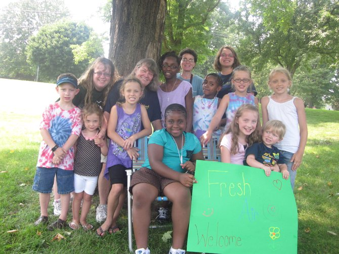 Some of the children from the Fresh Air Fund and their hosts in Saratoga County enjoying a summer day.