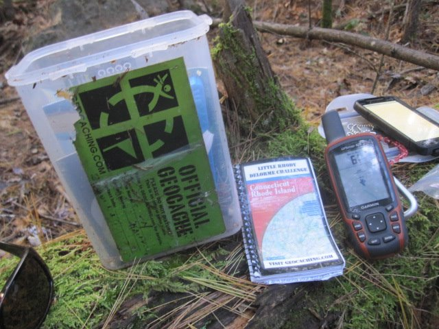 "A typical container for a geocache is waterproof, holds trinkets and perhaps a short note to the finder along with a register. Finders usually take an item and replace it with an item of equal or greater value. A popular saying amongst goeocachers is ""trade up or trade even."" Submitted photo."