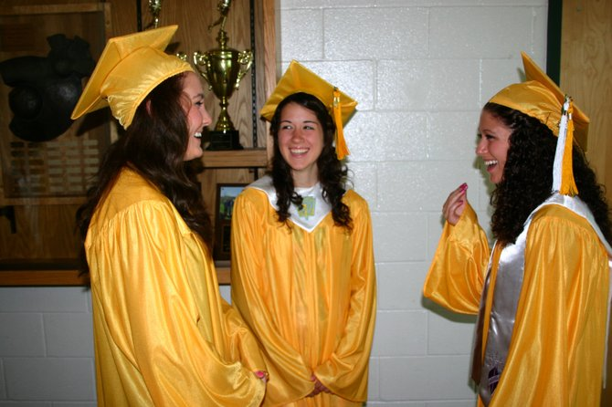 North Warren Seniors (left to right): Kiera Warner, Amanda Millington and Ashlee Maresca share a joke as they line up prior to graduation ceremonies Saturday June 23.