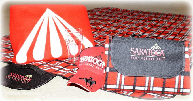 The 2012 Saratoga Race Course giveaways are a baseball hat, picnic mat, pilsner glass and fleece blanket.