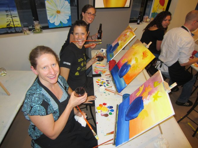 Recent guests at Saratoga&#39;s Paint and Sip Studio take a break from class. Submitted photo. 