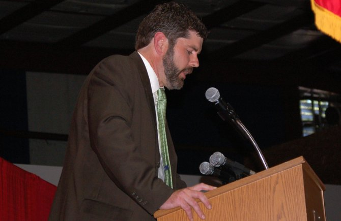 History teacher Joe Thill gives a speech during the Saranac Lake High School commencement June 22 at the Saranac Lake Civic Center.