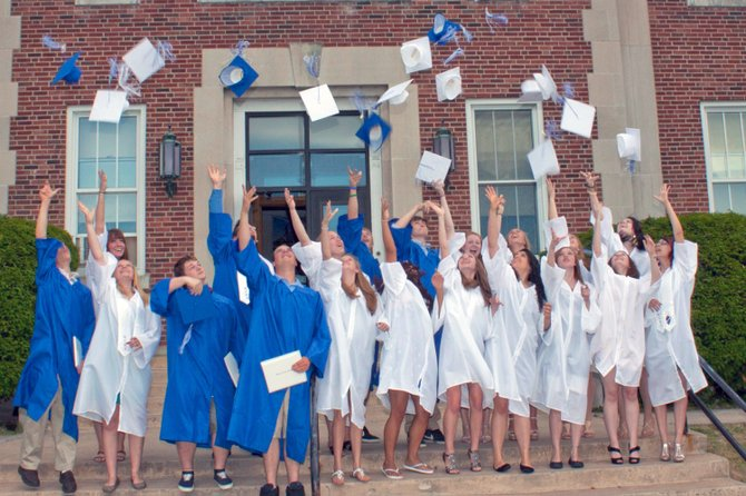 Westport Central graduates throw their caps into the air June 23.