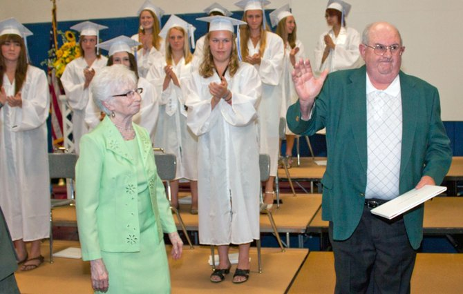 Floyd H. St. Clair waves to the crowd at the Westport Central School graduation June 23 after receiving an Operation Recognition diploma from school board president Alice LaRock and Superintendent Dr. John Gallagher.