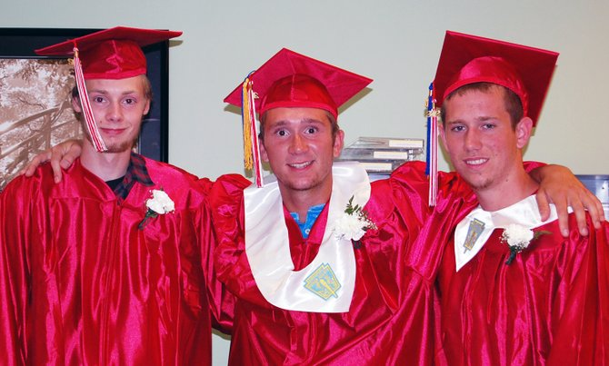 Willsboro Central School graduates Brandon Bertrand, Cody Sayward and Clay Sherman prepare for commencement ceremonies June 22. Sayward and Sherman will be roommates at Plattsburgh State in the fall.