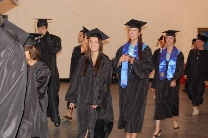 Plattsburgh seniors make their way into the Field House for graduation.