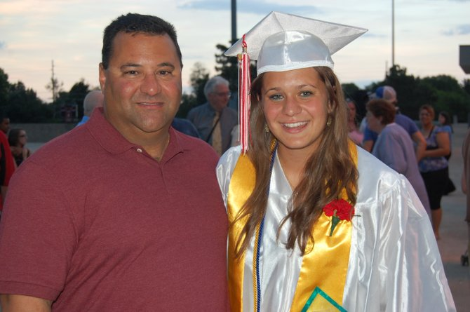 Valedictorian Sara LoTemplio stands with her father Joe.