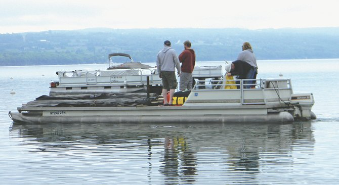 The Skaneateles Lake Association's milfoil removal boat and volunteers working on Skaneateles Lake in 2011.
