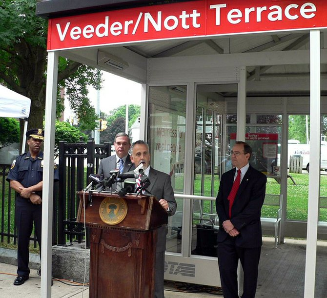 CDTA Chief Executive Officer Carm Basile speaks at the podium during a press conference on Monday, June 25, about surveillance cameras installed at BusPlus stations along State Street. Also pictured, from left, are Schenectady Chief of Police Mark Chaires, Schenectady Mayor Gary McCarthy and Schenectady County District Attorney Robert Carney.