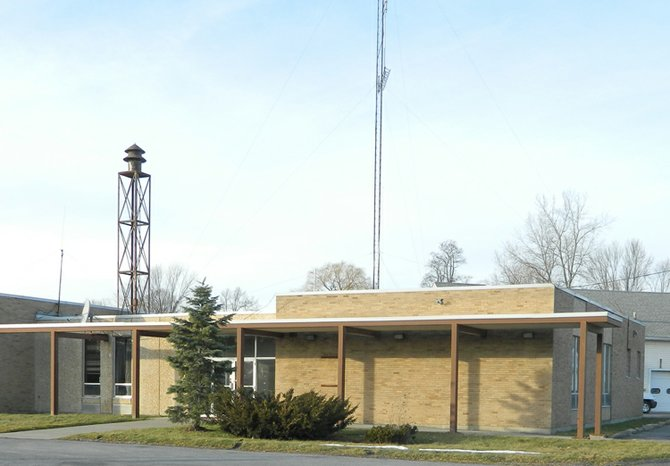 The old fire station/new village hall building on Fennell Street has a defunct 95-foot communications antenna, center, that needs to be removed. It is a dangerous job, however, and the village board wants the work done by professionals. The structure standing above the building to the left is the old whistle.