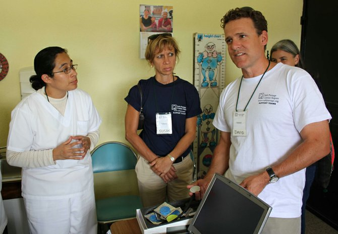 David Allyn, right, fourth generation family member and director of corporate social responsibility at Welch Allyn, and Sue Mangicaro, center, director of clinical affairs, donated Welch Allyn stethoscopes to a remote clinic during a mission trip to Guatemala earlier this month. The visit was part of a humanitarian effort sponsored by Heart to Heart International.