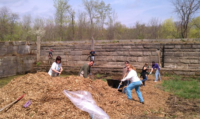Students clean up the site of an abandoned Lock as part of a project to design accessibility to the area. Submitted photo. 