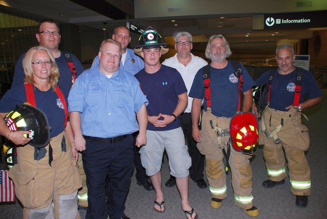 Members of the Selkirk Fire Department joined the family and friends of Jake Snide in welcoming the Marine home from a tour in Afghanistan