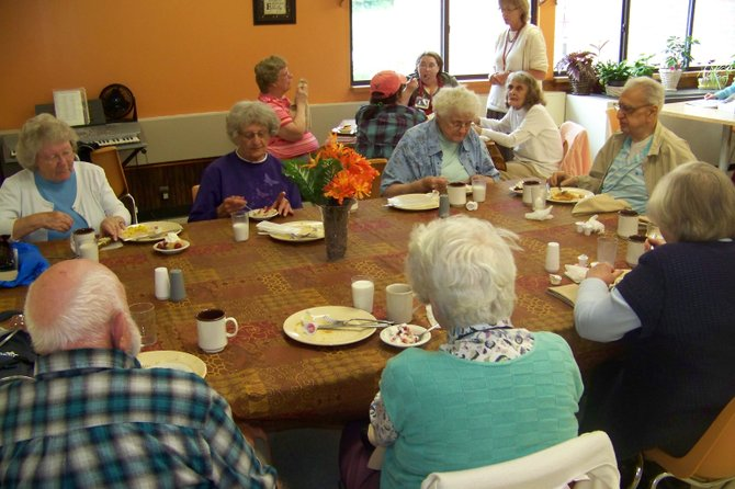 Seniors who formerly attended the Warrensburg community mealsite in the First United Methodist Church share a meal Jan. 25 at the program's new site at Countryside Adult Home north of Warrensburg on Schroon River Road.