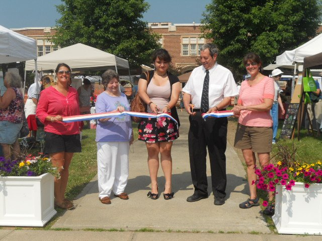Participating in the recent ribbon cutting ceremony for Chestertown's first-ever weekly Farmers' Market are (left to right):  Angie Mead, Mary Hane Dower, Ana Martha Torres, Fred Monroe and Dee Beckler. The Chestertown Farmers' Market has been hailed as a success by vendors, organizers and shoppers, and it is expected that the venue will be even busier by mid-summer with the arrival of second homeowners and vacationers.